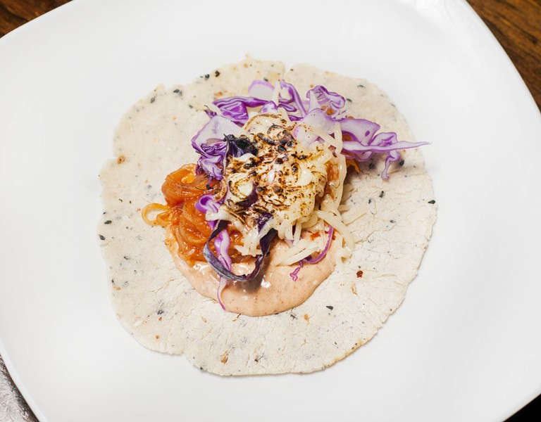 Brujo's vegeterian barbacoa taco with seared spaghetti squash that's tossed with barbacoa sauce, red cabbage ensalata, chipotle mayo, and Chihuahua cheese. - TOM PERKINS