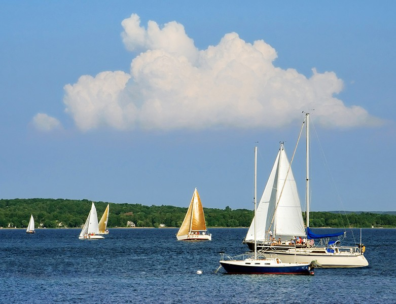 Sailboats on the blue water of Grand Traverse Bay. - COURTESY PHOTO