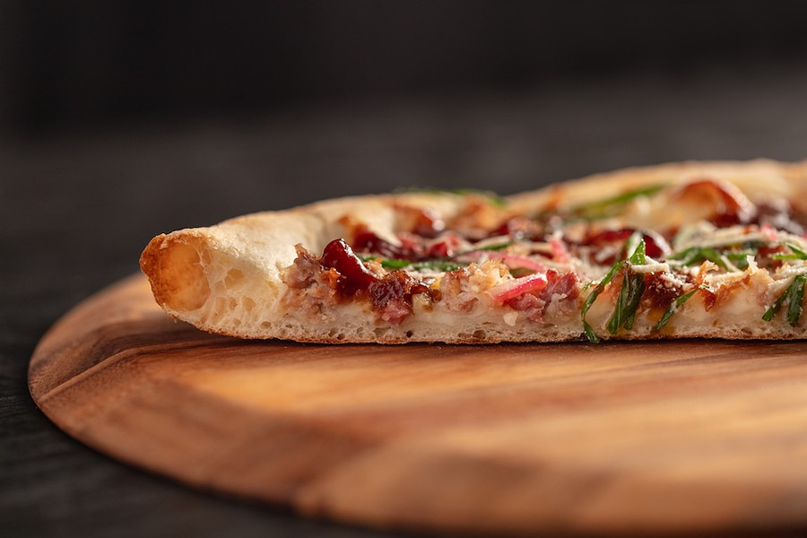 New York style pizza features a thin center crust with a crispy outer crust. - COURTESY OF MOOTZ PIZZERIA + BAR