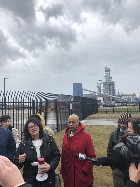 Rep. Rashida Tlaib and State Rep. Cynthia A. Johnson speak in front of protesters outside of the Marathon Petroleum Refinery in Southwest Detroit - WILL FEUER