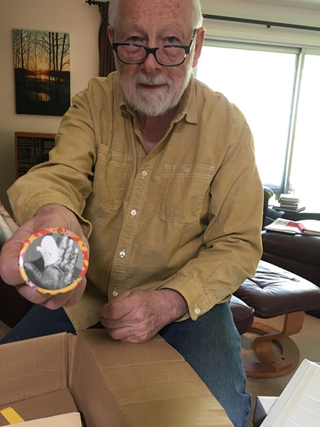 Ken Mikolowski, holding a button depicting poet Jim Gustafson's bandaged hand, will give a talk commemorating the 50th anniversary of the Alternative Press. - COURTESY OF MEREDITH COUNTS