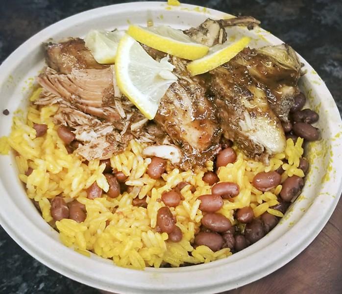 Jerk chicken with jollof rice. - COURTESY PHOTO
