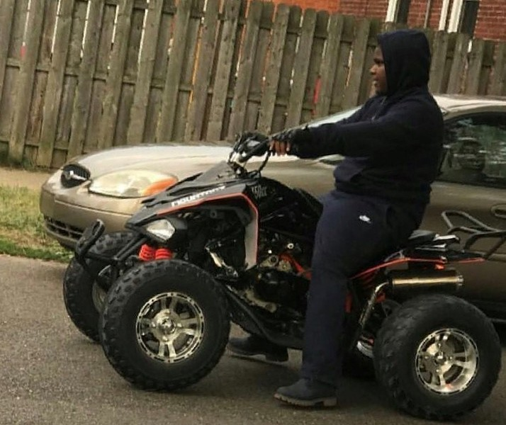 Damon Grimes on his four-wheeler before he died. - COURTESY OF FAMILY