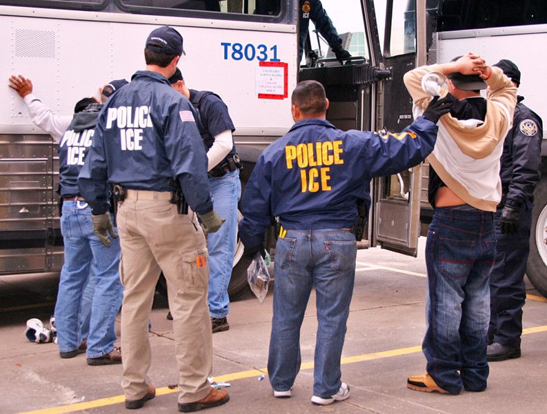ICE special agents arresting suspects during a raid. - IMMIGRATION CUSTOMS AND ENFORCEMENT