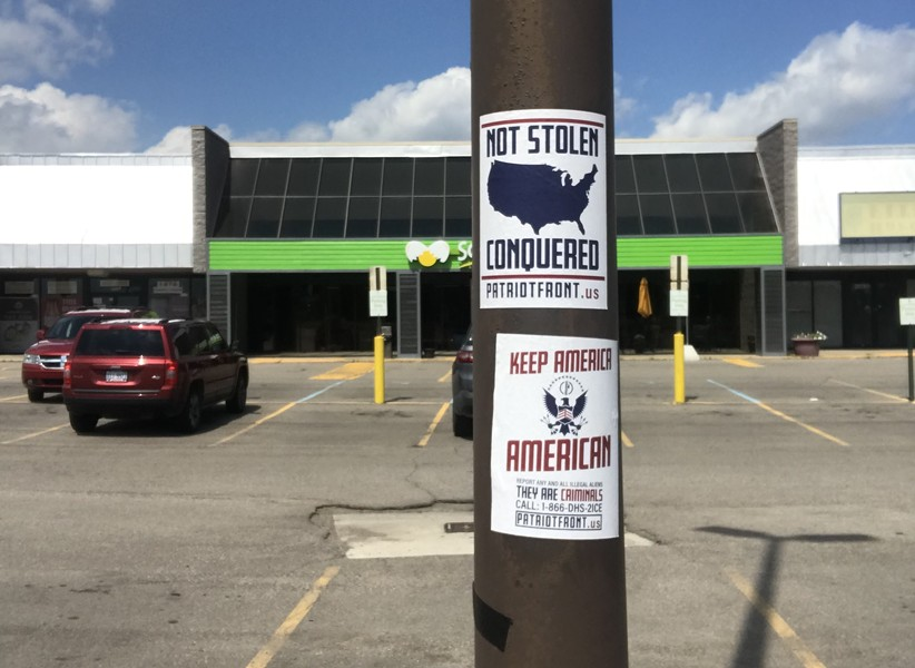 Patriot Front posters in a parking lot on 13 Mile Road near Little Mack Avenue in Roseville. - COLLIN KEEN