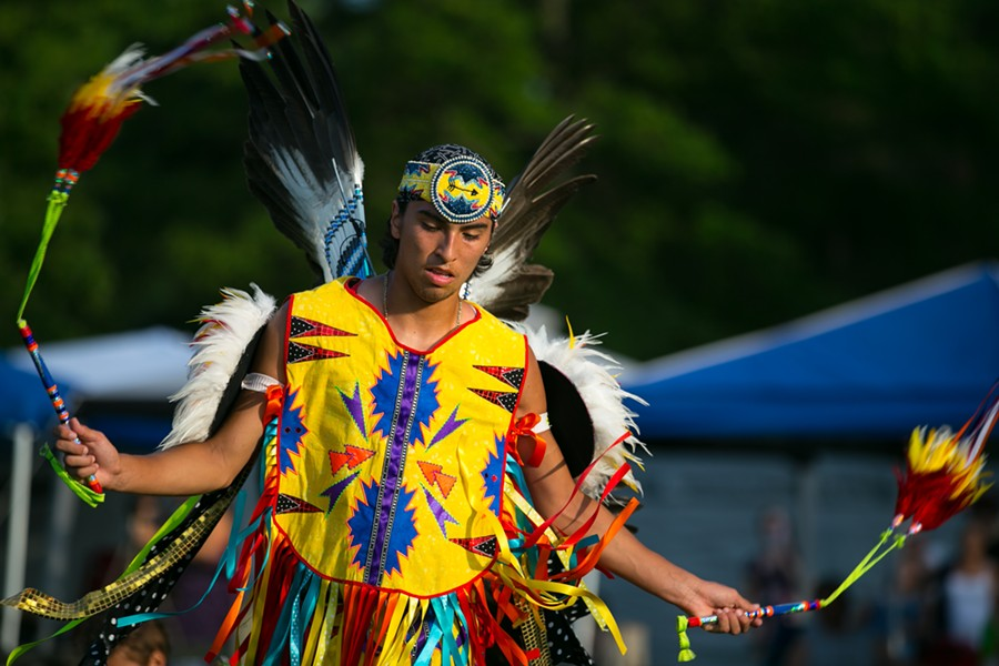 A young male fancy dancer at the Little River Band of Ottawa Indians annual Pow wow, in full regalia. - DARLENE STANLEY / SHUTTERSTOCK.COM