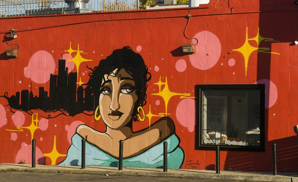 A mural on River Bistro's wall. - TOM PERKINS