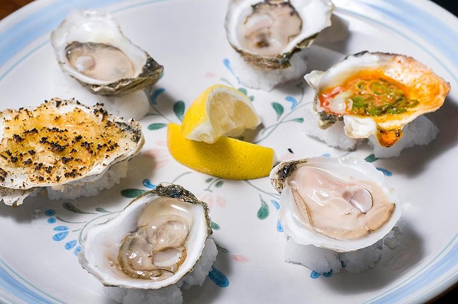 Island Creek oysters at Mabel Gray. - TOM PERKINS