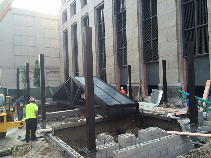 Crews work on building the retractable, glass rooftop that will cover the dining space at Townhouse, in this shot posted last month. - FACEBOOK