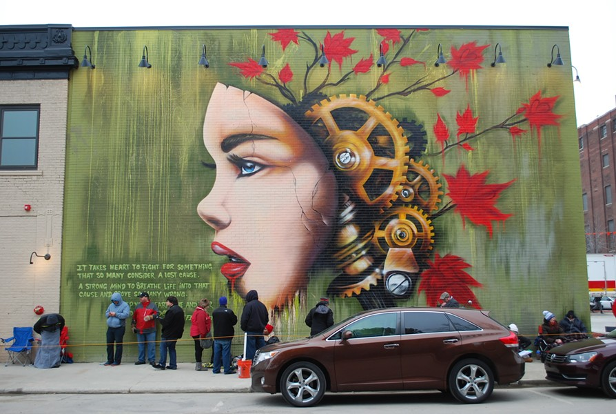 The artist Fel3000ft was commissioned to paint a mural on the side of Detroit's HopCat. - COURTESY PHOTO
