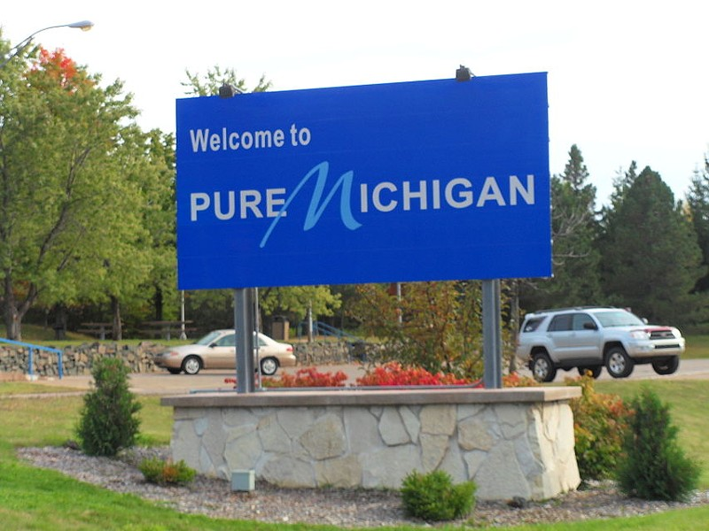 Pure Michigan sign welcomes visitors to the state - LOVEMYKIA VIA WIKIMEDIA COMMONS