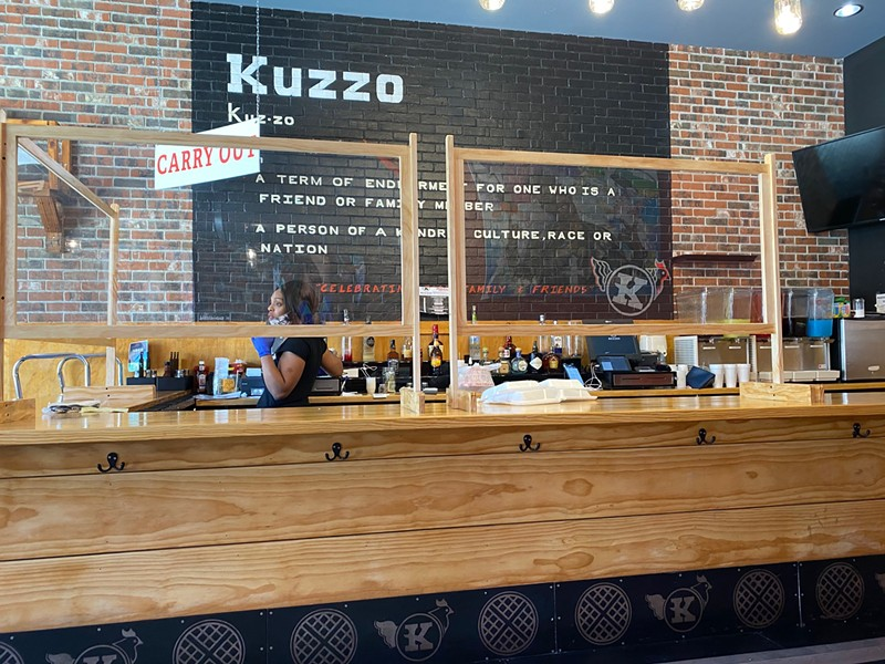 The coronavirus crisis came to Michigan just as Detroit's Kuzzo's Chicken & Waffles returned from a hiatus. The restaurant was forced to quickly adapt, installing plexiglass panes and pivoting to takeout service. - DAVID RUDOLPH PR