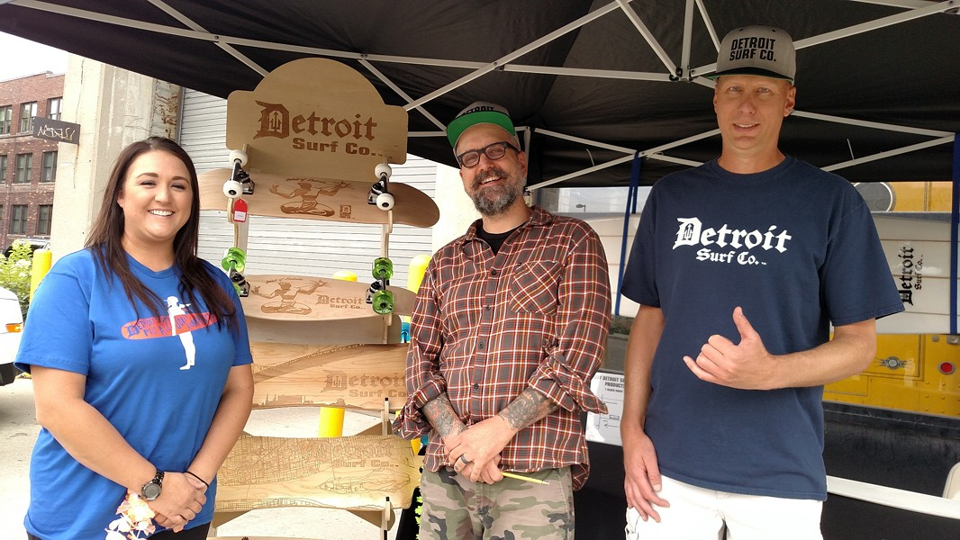 Jolly Pumpkin Pizzeria and Brewery General Manager Shelby Oberstaedt, Jolly Pumpkin Beer Label Artist Adam Forman and Detroit Surf Co. Owner Dave Tuzinowski celebrated their collaboration at the Detroit Luau Party on July 16. - COURTESY OF JOLLY PUMPKIN