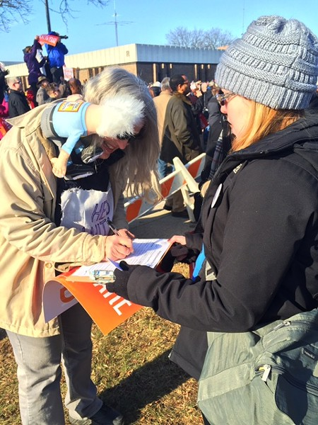 Kelly Collison, founder of Michigan for Revolution, signs up a woman who supported Vermont Sen. Bernie Sanders in the Democratic presidential primary. - VIOLET IKONOMOVA