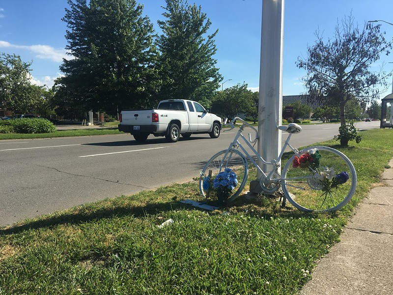 "A ""ghost bike"" shrine memorializes a cyclist killed on Warren Avenue near the Chrysler Service Drive. - ISABELLA HINOJOSA"