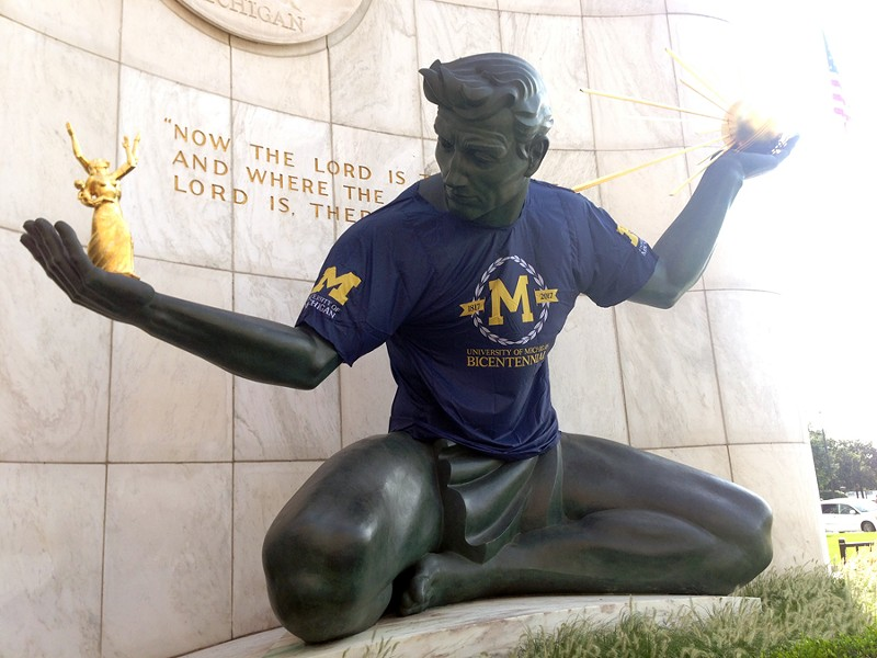 The Spirit of Detroit decked in maize and blue in honor of the University of Michigan's bicentennial. - LEE DEVITO