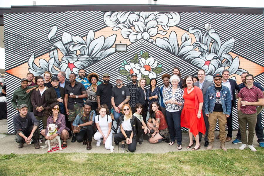 Some of Murals in the Markets' participating artists, photographed at a launch event at Eastern Market. - COURTESY PHOTO