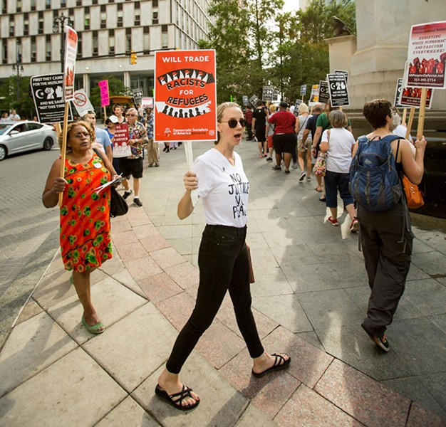 DSA steering committee member Naomi Burton marches in an anti-fascist rally in Detroit following last summer's car attack in Charlottesville, Va. - NICK HAYES