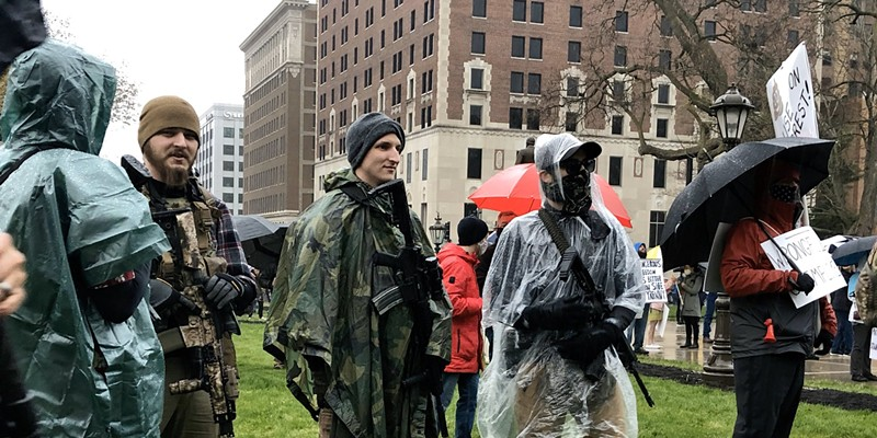 Protesters with rifles outside the state Capitol