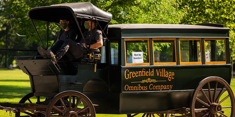 """Greenfield Village is offering rides in its old-timey """"Omnibus"""" horse-drawn carriages."""