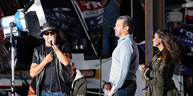 Kid Rock, Donald Trump Jr, and Kimberly Guilfoyle  campaign at at Trump rally in Harrison Township in September.