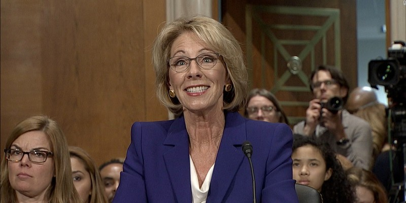 Betsy's at it again, comparing schools to ride-sharing apps