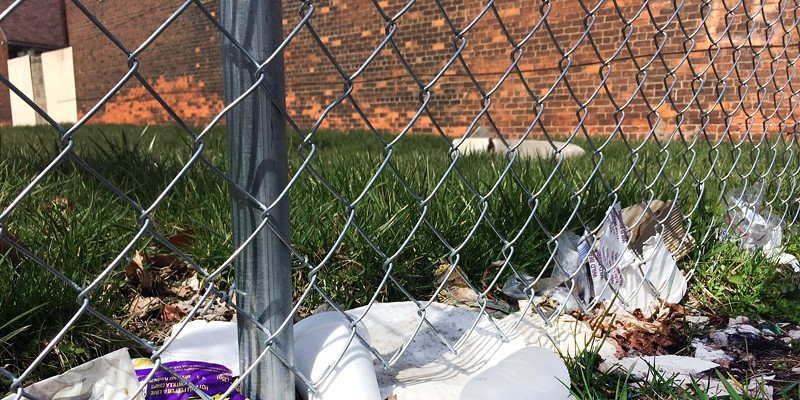 Trash along one of Henry Velleman's fences pictured earlier this spring.