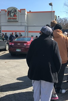A line snakes around the parking lot of the Little Caesars in Ferndale ahead of Monday's free lunch combo promo.
