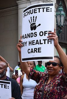 Protesters fight Michigan's Medicaid work requirements outside the Detroit office of gubernatorial candidate and Attorney General Bill Schuette.
