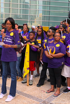 Detroit janitor represented by the SEIU joins in announcing vote to strike if demands for $15-an-hour minimum wage aren't met.