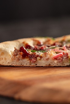 New York style pizza features a thin center crust with a crispy outer crust.