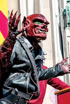 "The ""Red Dwarf"" speaks at the Marche du Nain Rouge, 2015."