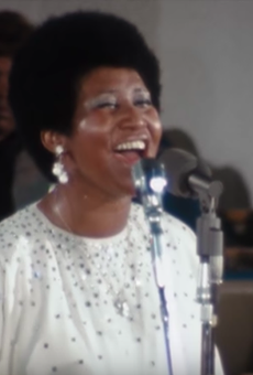 Aretha Franklin singing to the congregation at New Temple Missionary Baptist Church.