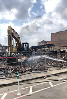 A crew demolishes the Gold Dollar in the Cass Corridor.
