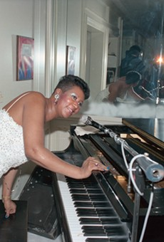 Aretha Franklin entertaining at her home during one of her Christmas parties.