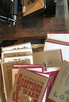 You can make holiday cards on an old-school letterpress in Eastern Market on Friday