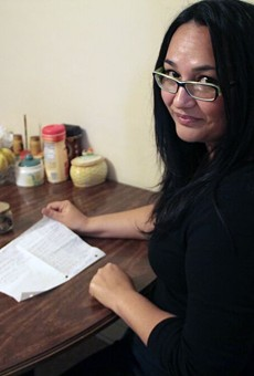 Ofelia Saenz with a list of ingredients for Dona Marta Nino's family mole.