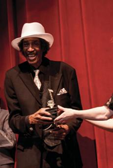 Melvin Davis accepts an award at the 2018 Detroit Music Awards.