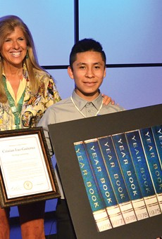 Pictures of Hope founder Linda Solomon with 13-year-old Cesar Chavez Middle School student Cristian Luz-Gutierrez during a reception Thursday at WXYZ.