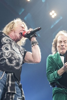 Axl Rose and Angus Young onstage at The Palace of Auburn Hills on Friday.