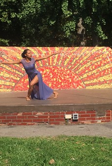 """The Detroit-Windsor Dance Academy's Amber Moore performs """"Crowned"""" during an Open Streets event at Clark Park on Tuesday."""