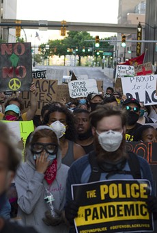 Protesters march in downtown Detroit on Thursday.