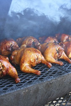 Chicken on the smoker at Satchel's BBQ.