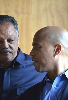 The Rev. Jesse Jackson and U.S. Sen. Cory Booker chat Thursday at Kuzzo's Chicken & Waffles in Detroit.