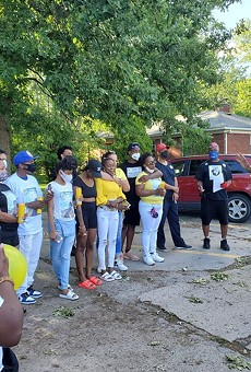 Family members and friends of Pricilla Slater outside the Harper Woods Police Department.