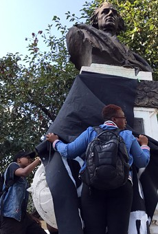 Protesters draped a black cloth over the Christopher Columbus statue in downtown Detroit in August 2017.