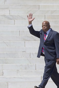 Georgia Congressman John Lewis waves at the 50th Anniversary of the march on Washington and Martin Luther King's I Have A Dream Speech in 2013.
