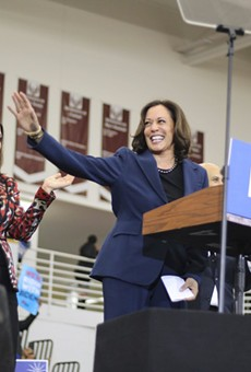 Gov. Gretchen Whitmer (left) with Kamala Harris at a Joe Biden rally.