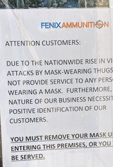 Novi ammo store's anti-mask sign was nothing more than 'a publicity stunt,' police say