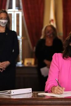 Gov. Gretchen Whitmer signs a previous bill.
